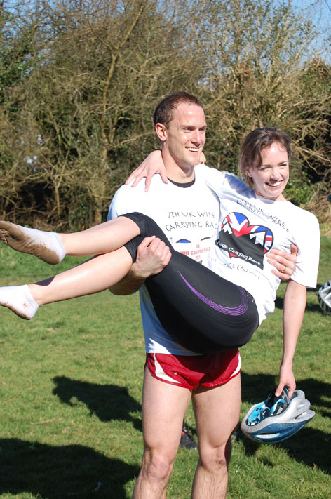 Winner of the UK Wife Carrying Race 2014 Rich Blake Smith and Hannah